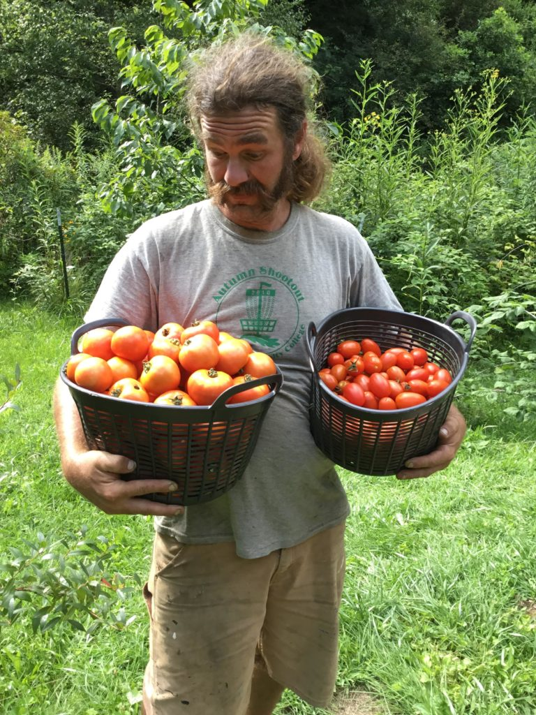 Dustin of Sustainabillies with tomatoes