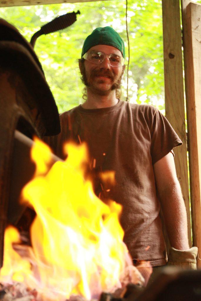 Dustin Sustainabillies behind epic metal fire