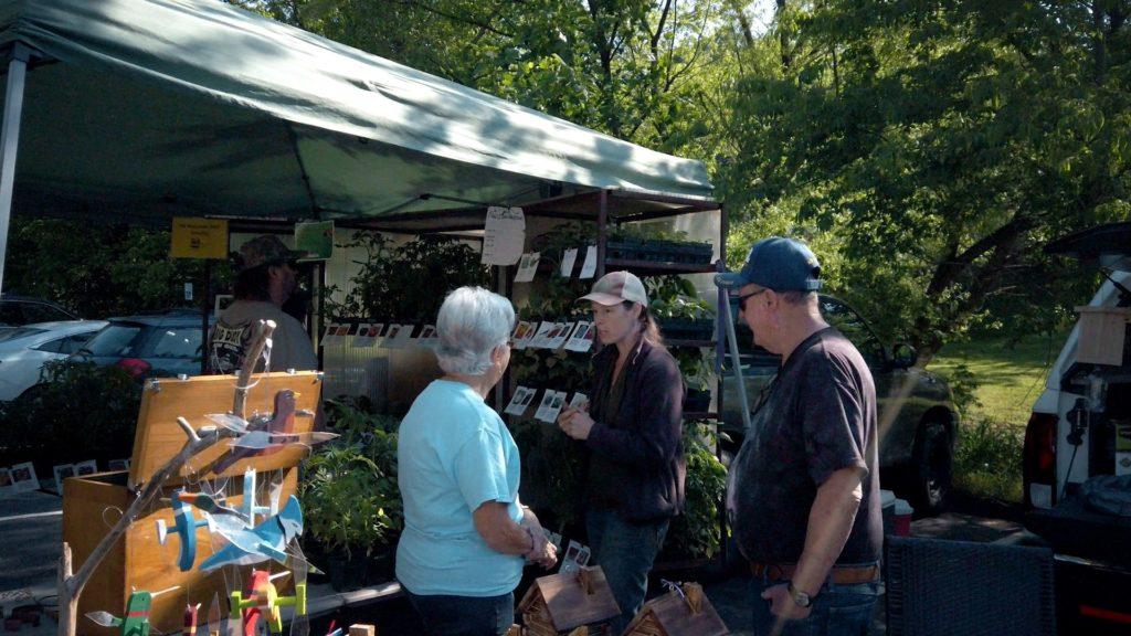 Sara talking to customers at farmers market
