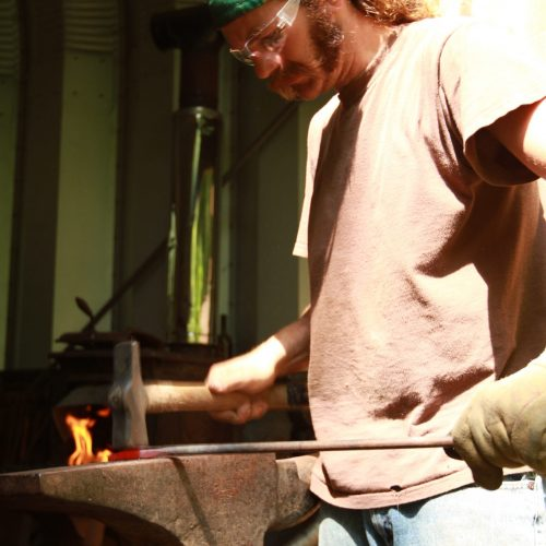 Dustin Sustainabillies flattening metal on anvil